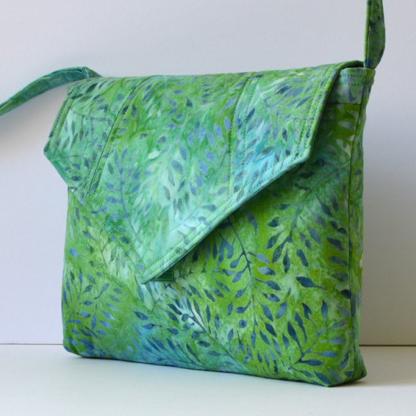 Small pouch-style  shoulder bag with 'hidden' pocket in green and lavender leaf design