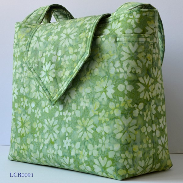 Light green handbag with a floral pattern