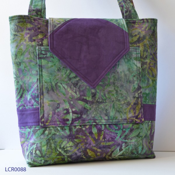 Handbag  with purple and green floral pattern and a purple stripe