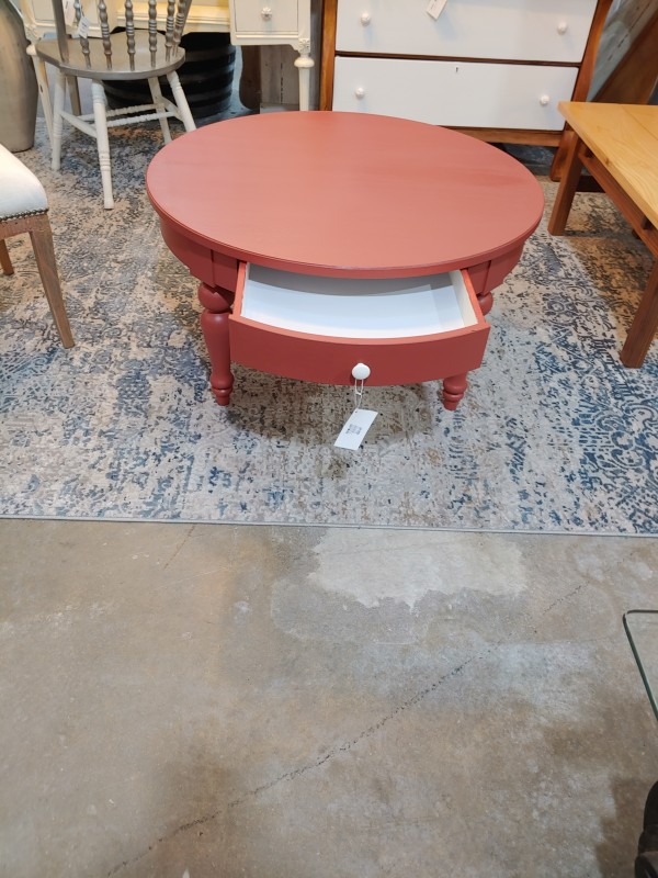 Burnt red table with drawer